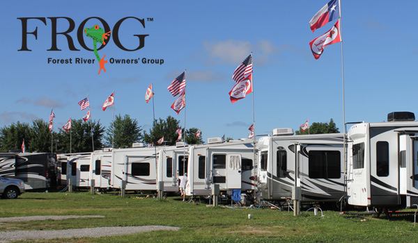 Row of RVs flying multi-national flags